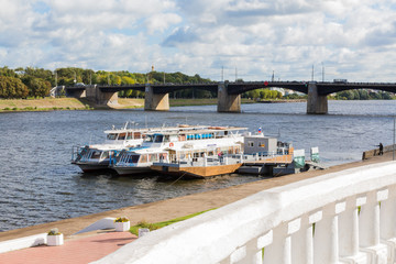 Embankment of the river Volga in Tver, Russia. Autumn Sunny day. Pleasure boats at the pier. The new Volga bridge.