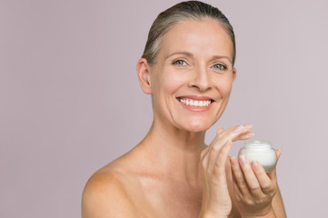 Woman holding jar of moisturizer