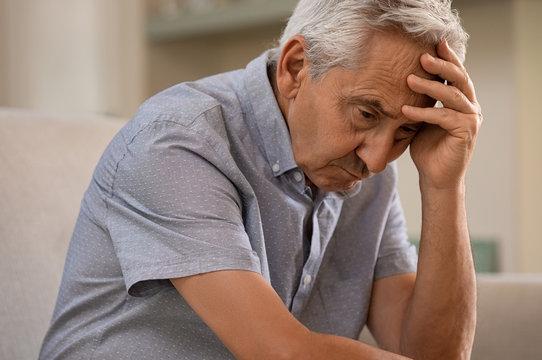 Depressed senior man at home