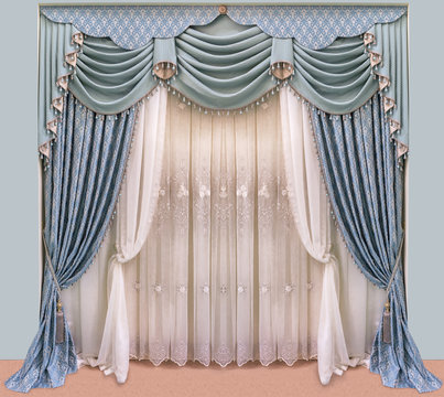 Decoration of the interior of the living room in the classical, palace style. Curtains of dense fabric with blue ornaments, lambrequin, pelmet, jabot, and tulle with embroidery