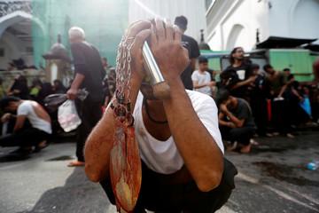 A Shi'ite muslim man attends the Ashura festival in central Yangon