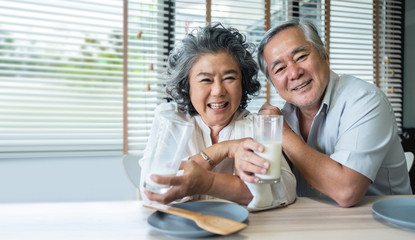 Asian Senior Couple drinking milk together.