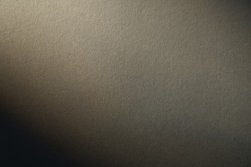 light gradient on a grey cardboard background