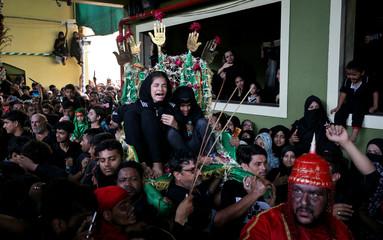 Shi'ite Muslims take part in a Muharram procession to mark Ashura, in Mumbai