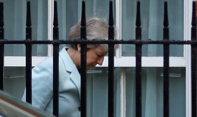 Britain's Prime Minister Theresa May arrives at the back entrance of 10 Downing Street in London