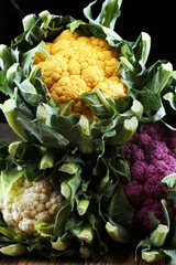 Colorful cauliflower cabbages on table. Healthy food.