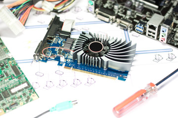 Broken graphics card with computer parts on white background. Selective focus