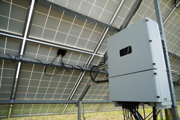 Inverter behind the solar panels. Renewable energy.