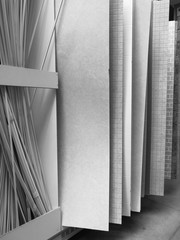 Black and white photo. Sale of PVC panels in the hypermarket.