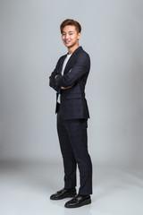 Studio portrait of a confident young East Asian business man