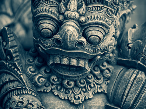 Traditional stone statues depicting demons in Bali,Indonesia