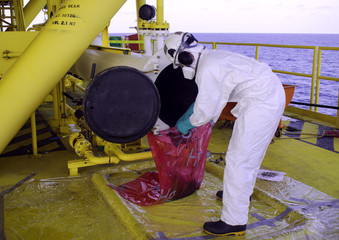 The operator cleaning pig launcher on oil and gas wellhead platform. Pig passage detector. Pig capsule on boat.