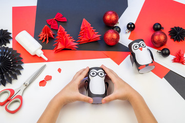 Children's master class hand-made paper penguin.