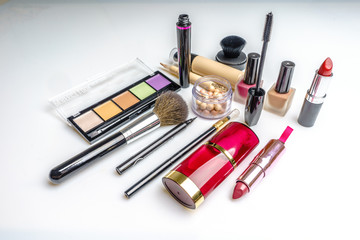 Makeup, cosmetics products on light background. Top view. Decorative cosmetics and accessory with empty space