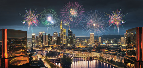 High resolution aerial panoramic view of Frankfurt, Germany with fireworks in the sky.