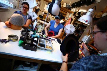 Employees of headwear manufacturer Muehlbauer work on hats at their workshop in Vienna