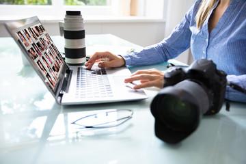Editor Retouching Photos On Laptop