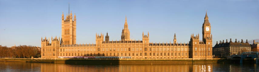 Panoramic view of the river Thames embankment with famous landmarks Big Ben, Houses of Parliament with beautiful blue sky in the morning. London, UK. April, 2006 Wall mural