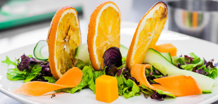 Salad preparation on chef's table