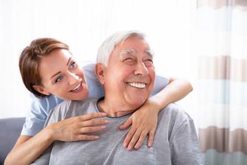 Nurse Pointing At Something To Senior Man
