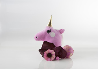 CUTE UNICORN HEAD WITH FLOWERS ON WHITE BACKGROUND