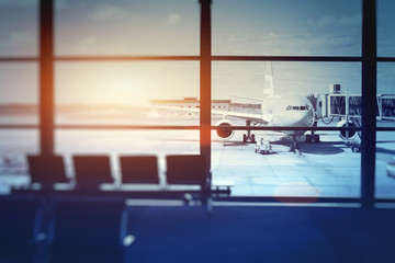 Wall Murals Airport airplane waiting for departure in airport terminal, blurred horizontal background with place for text