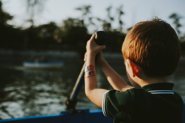 Kid in a boat