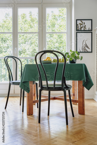 Black Chair Next To A Table With Green Cloth In Dining Room Interior Balcony Window The Background Real Photo