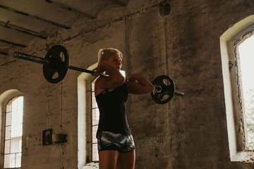 Female athlete in top front squat position
