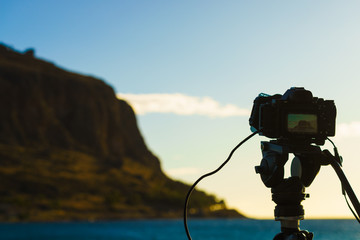 Camera on tripod and Monemvasia island