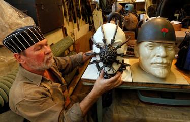 Blacksmith Kolchin works on a collection of forged headwear in Krasnoyarsk