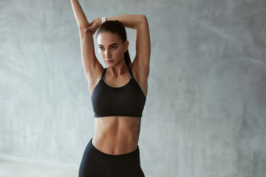 Sports Woman In Fashion Sport Clothes Stretching Body