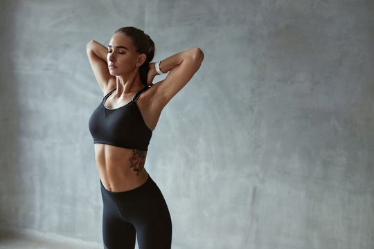 Fitness Woman Stretching Arms In Stylish Black Sport Clothes