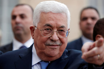 Palestinian President Mahmoud Abbas reacts after a meeting at the Elysee Palace in Paris