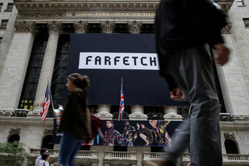 A banner to celebrate the IPO of online fashion house Farfetch is displayed on the facade of the of the NYSE in New York