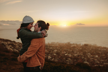 Loving couple at sunset in mountains