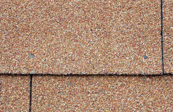 red and tan asphalt shingles on the side of a building