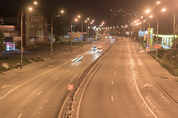 Kyiv, Ukraine- July 14, 2018: Highway at night with long exposure and traces of automobile headlights.