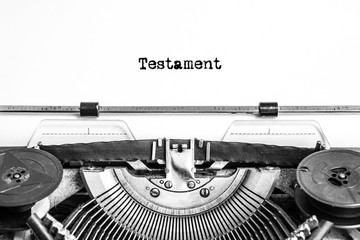 Testament text typed on an old typewriter, vintage paper, closeup recognition, inheritance, notary