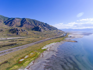 Aerial view of Antelope Island on Great Salt Lake and Interstate Highway 80 in Great Salt Lake State Park, Utah, USA.