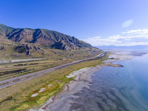 Aerial view of Antelope Island on Great Salt Lake and Interstate Highway 80 in Great Salt Lake State Park, Utah, USA.