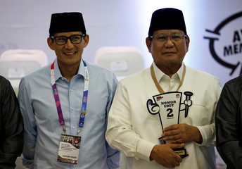 Presidential candidate in next year's election Prabowo Subianto, a retired special forces commander, and his running mate Sandiaga Uno attend a ceremony at the election commission headquarters in Jakarta