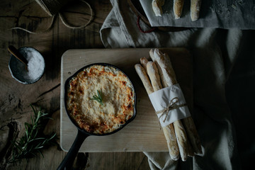 Melted cheese dip served with breadsticks