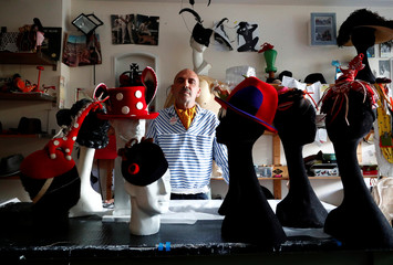 Belgian hat-designer Elvis Pompilio poses with hats in Brussels