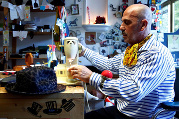 Belgian hat-designer Elvis Pompilio works in his workshop in Brussels