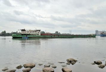 Cargo ship on river.