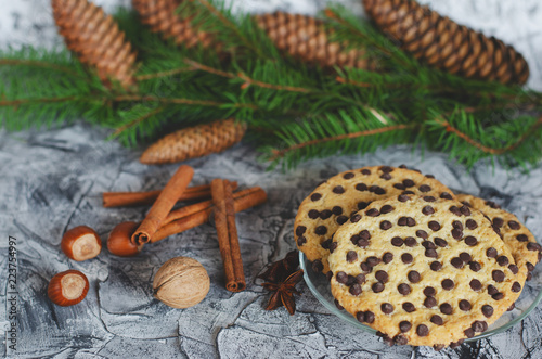 Christmas cookies with chocolate drops,cinnamon sticks and nuts decorated with fin .Vegetarian food