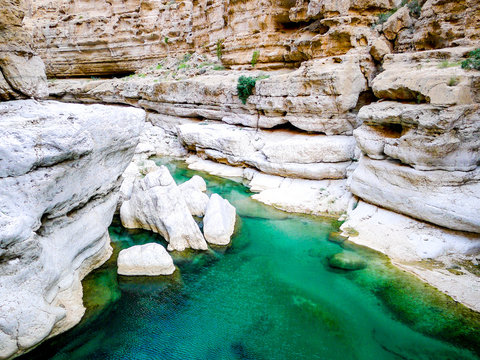 Bright, turquoise blue waters of Wadi Shab, a canyon near Muscat in Oman