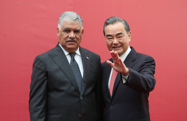 China's Foreign Minister Wang Yi and Dominican Republic's Chancellor Miguel Vargas pose during the opening of the first Chinese Embassy in the Dominican Republic, in Santo Domingo