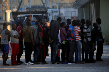 Migrants are seen after disembarking a rescue boat at the port of Malaga